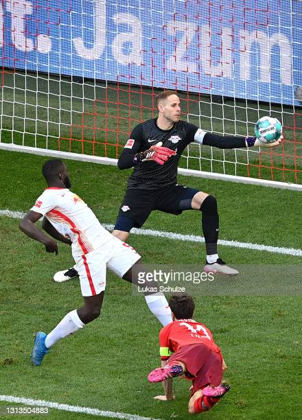 Jonas Hector of 1.FC Koeln scores their team's first goal past Peter Gulacsi of RB Leipzig during the Bundesliga match between 1. FC Koeln and RB...