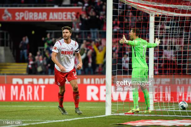 Jonas Hector of Cologne celebrates after scoring his teams third goal during the Bundesliga match between 1 FC Koeln and VfL Wolfsburg at...