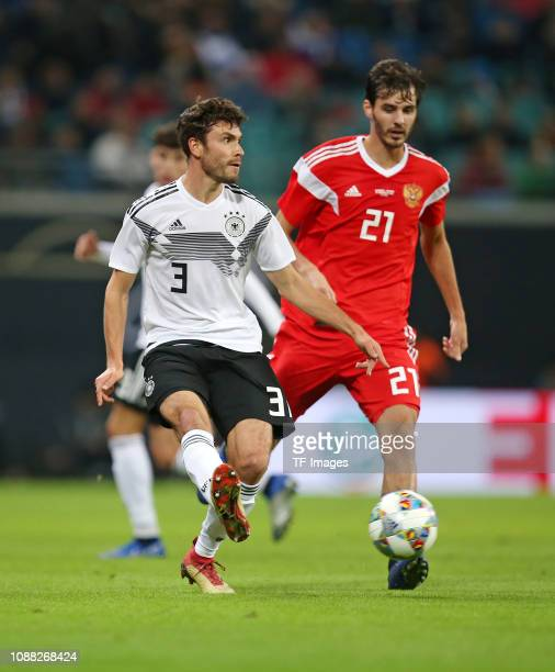 Jonas Hector of Germany and Aleksandr Erokhin of Russia controls the ball during the International Friendly match between Germany and Russia at Red...