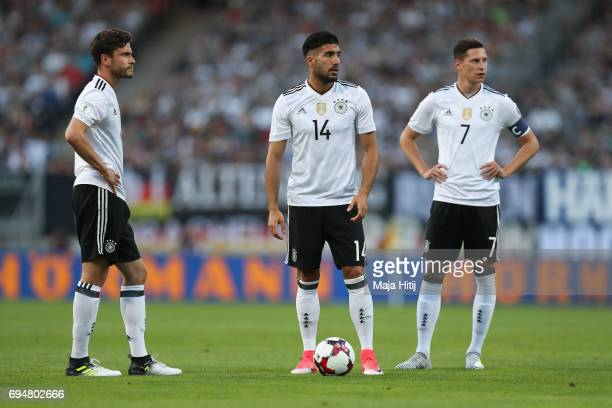 Jonas Hector of Germany Emre Can and Julian Draxler of Germany stand during the FIFA 2018 World Cup Qualifier Match between Germany and San Marino on...