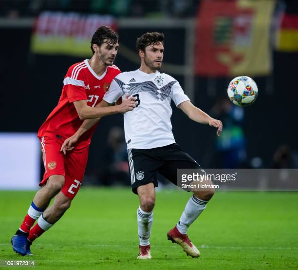Jonas Hector of Germany is challenged by Aleksandr Erokhin of Russia during the International Friendly match between Germany and Russia at Red Bull...