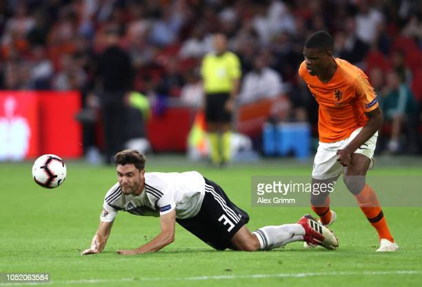 Jonas Hector of Germany is challenged by Denzel Dumfries of the Netherlands during the UEFA Nations League A group one match between Netherlands and...