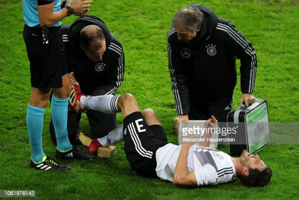 Jonas Hector of Germany is seen injured during the International Friendly match between Germany and Russia at Red Bull Arena on November 15, 2018 in...