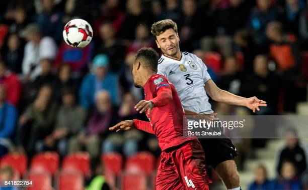 Jonas Hector of Germany jumps for a header with Theodor Gebre Selassie of Czech Republic during the FIFA 2018 World Cup Qualifier between Czech...