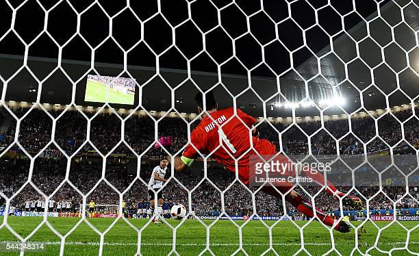 Jonas Hector of Germany scores at the penalty past Gianluigi Buffon of Italy shootout to win the game during the UEFA EURO 2016 quarter final match...