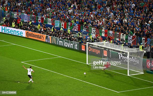Jonas Hector of Germany scores at the penalty shootout to win the game during the UEFA EURO 2016 quarter final match between Germany and Italy at...