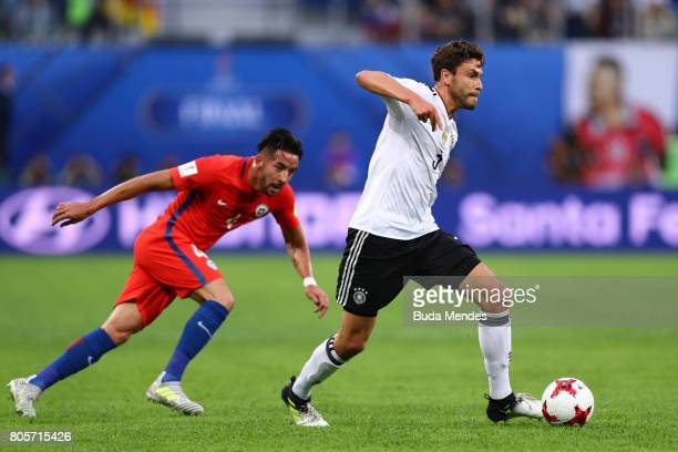 Jonas Hector of Germany takes the ball past Mauricio Isla of Chile during the FIFA Confederations Cup Russia 2017 Final between Chile and Germany at...