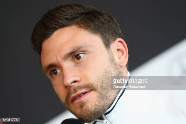 Jonas Hector of Germany talks to the media during a press conference of the German National team at MercedesBenzMuseum on August 30 2017 in Stuttgart...