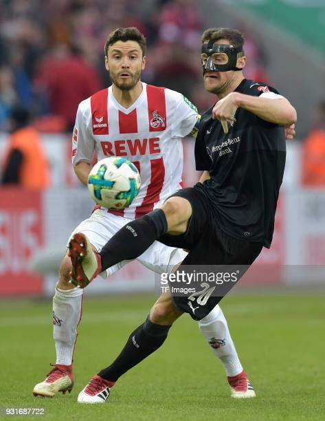Jonas Hector of Koeln and Christian Gentner of Stuttgart battle for the ball during the Bundesliga match between 1 FC Koeln and VfB Stuttgart at...