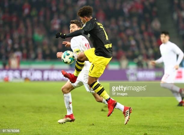 Jonas Hector of Koeln and Jadon Malik Sancho of Dortmund battle for the ball during the Bundesliga match between 1 FC Koeln and Borussia Dortmund at...