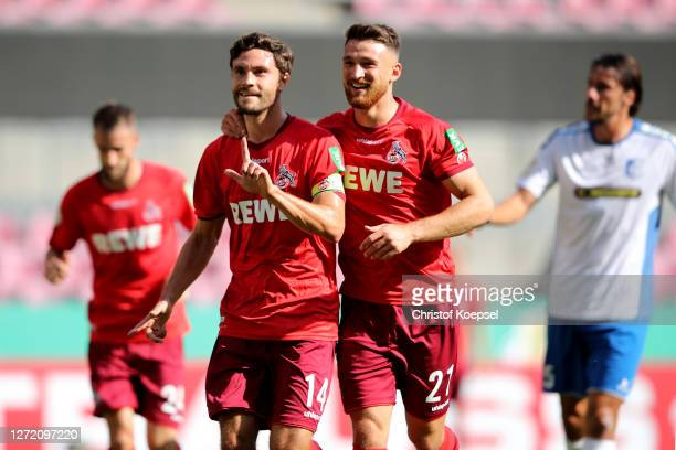 Jonas Hector of Koeln celebrates the first goal with Salih Oezcan of Koeln during the DFB Cup first round match between VSG Altglienicke and 1. FC...