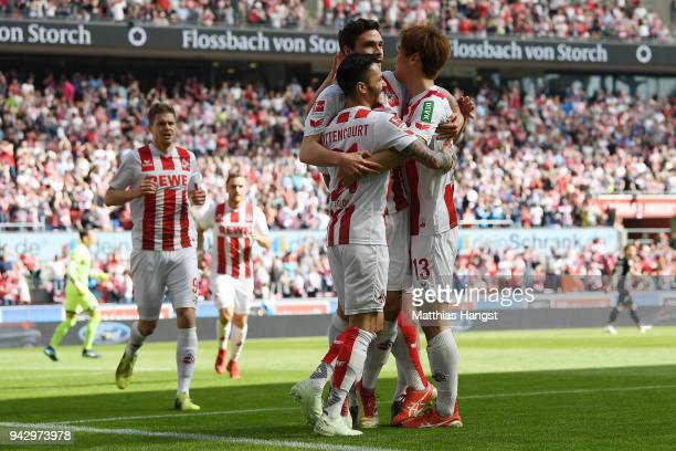 Jonas Hector of Koeln celebrates with his team after he scored a goal to make it 10 during the Bundesliga match between 1 FC Koeln and 1 FSV Mainz 05...