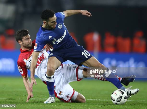 Jonas Hector of Koeln challenges Nabil Bentaleb of Schalke during the Bundesliga match between 1 FC Koeln and FC Schalke 04 at RheinEnergieStadion on...