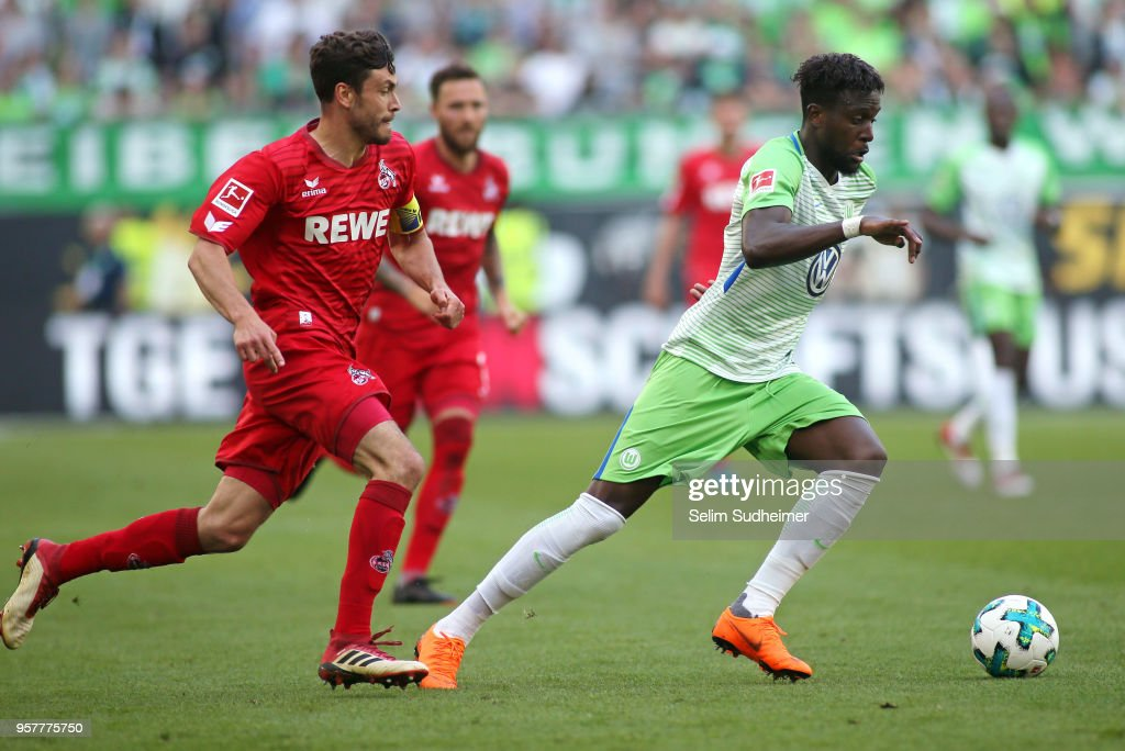 Jonas Hector of Koeln (L) fights for the ball with Divock Origi of Wolfsburg during the Bundesliga match between VfL Wolfsburg and 1. FC Koeln at Volkswagen Arena on May 12, 2018 in Wolfsburg, Germany.