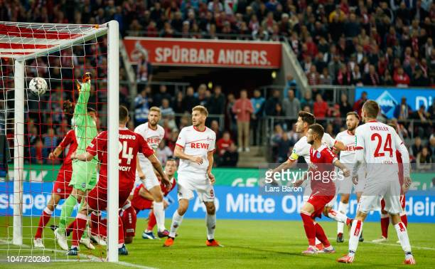Jonas Hector of Koeln heads his teams first goal during the Second Bundesliga match between 1 FC Koeln and MSV Duisburg at RheinEnergieStadion on...