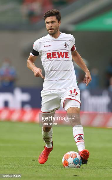 Jonas Hector of Koeln runs with the ball during the Bundesliga match between 1. FC Köln and Hertha BSC at RheinEnergieStadion on August 15, 2021 in...