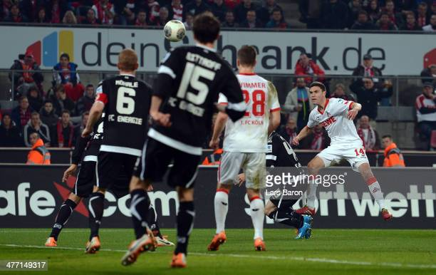 Jonas Hector of Koeln scores his teams first goal during the Second Bundesliga match between 1 FC Koeln and Energie Cottbus at RheinEnergieStadion on...