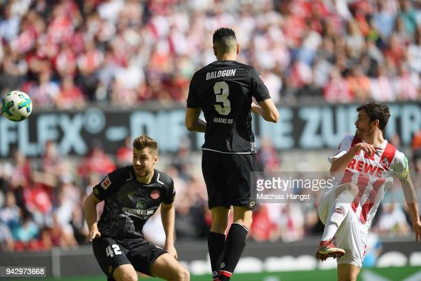 Jonas Hector of Koeln shoots on target and scores a goal to make it 10 during the Bundesliga match between 1 FC Koeln and 1 FSV Mainz 05 at...