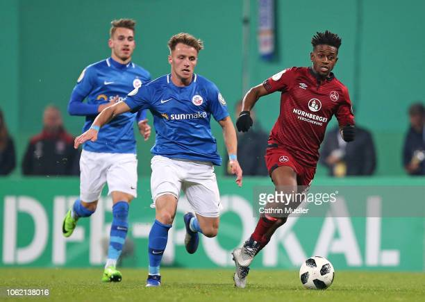 Jonas Hildebrandt and Mirnes Pepic of Hansa Rostock and Virgil Misidjan of 1 FC Nuernberg battle for the ball during the DFB Cup second round match...