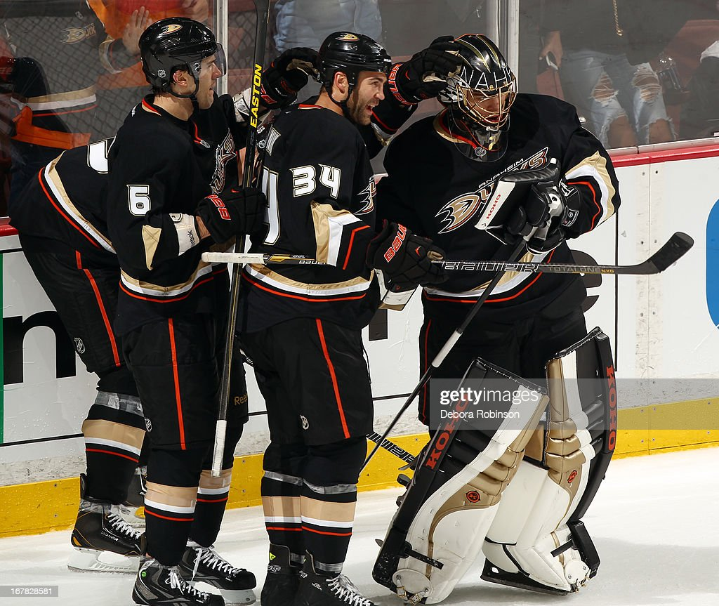 Jonas Hiller #1, Daniel Winnik #34 and Ben Lovejoy #6 of the Anaheim Ducks celebrate after the Ducks 3-1 win against the Detroit Red Wings in Game One of the Western Conference Quarterfinals during the 2013 NHL Stanley Cup Playoffs at Honda Center on April 30, 2013 in Anaheim, California.