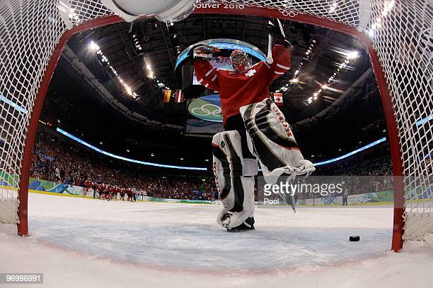 Jonas Hiller of Switzerland celebrates making the gamewinning save on a shootout attempt during the ice hockey Men's Qualification Playoff game...