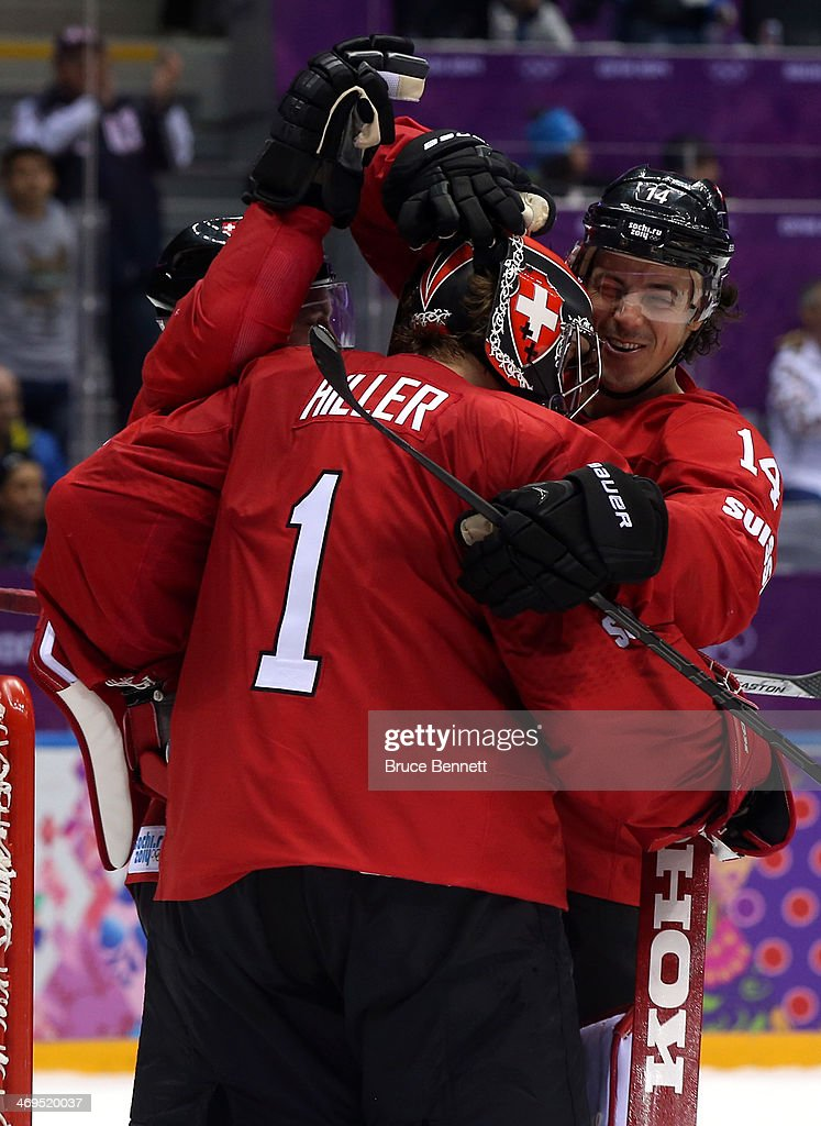Jonas Hiller #1 of Switzerland celebratse with his teammate Roman Wick #14 after defeating the Czech Republic 1 to 0 in the Men's Ice Hockey Preliminary Round Group C game on day eight of the Sochi 2014 Winter Olympics at Bolshoy Ice Dome on February 15, 2014 in Sochi, Russia.