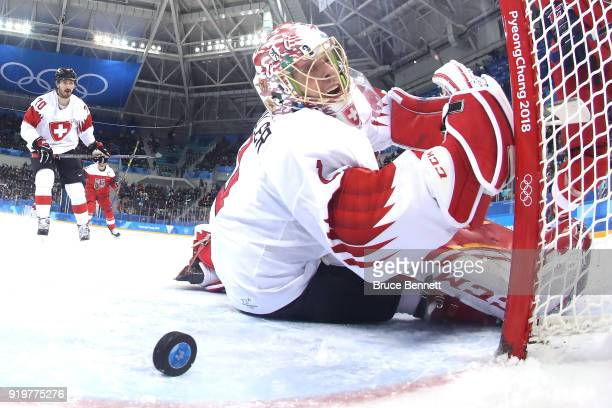 Jonas Hiller of Switzerland gives up a goal to Dominik Kubalik of the Czech Republic in the third period during the Men's Ice Hockey Preliminary...