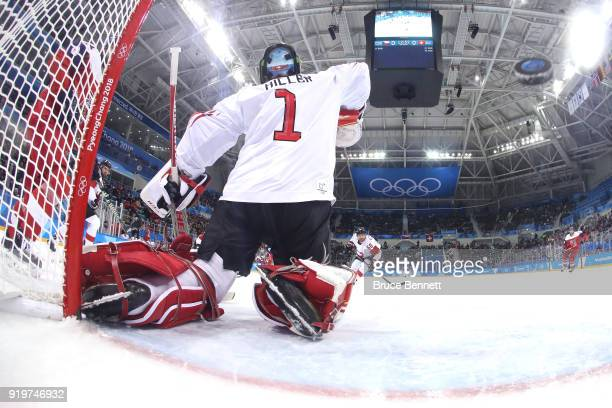 Jonas Hiller of Switzerland gives up a goal to Michal Repik of the Czech Republic in the first period during the Men's Ice Hockey Preliminary Round...