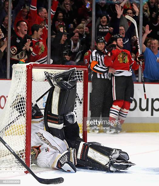 Jonas Hiller of the Anaheim Ducks ends up on his back in the net after Bryan Bickell of the Chicago Blackhawks scored a goal in the third period at...