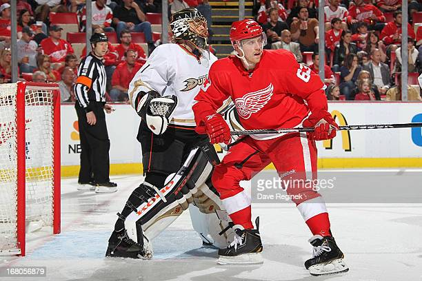 Jonas Hiller of the Anaheim Ducks follows the play while Joakim Andersson of the Detroit Red Wings attempts to screen during Game Three of the...