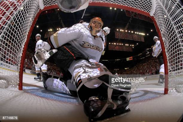 Jonas Hiller of the Anaheim Ducks looks in the net as the puck during Game Seven of the Western Conference Semifinal Round of the 2009 Stanley Cup...