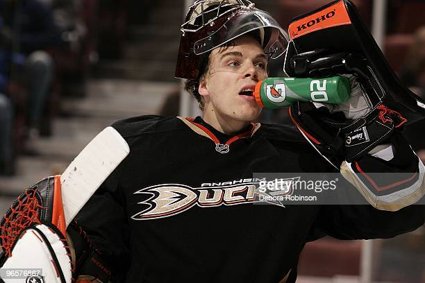 Jonas Hiller of the Anaheim Ducks take a water break during a break in play against the Edmonton Oilers on February 10, 2010 at Honda Center in...