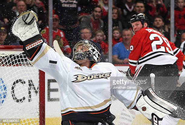 Jonas Hiller of the Anaheim Ducks tries to make a save on a goal shot by Bryan Bickell of the Chicago Blackhawks at the United Center on January 17,...