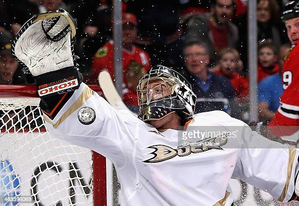 Jonas Hiller of the Anaheim Ducks tries to make a save on a goal shot by Bryan Bickell of the Chicago Blackhawks at the United Center on January 17...