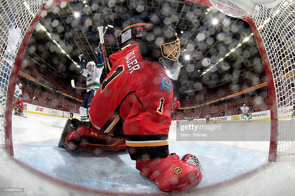 Jonas Hiller #1 of the Calgary Flames looks into the net after a goal for the Vancouver Canucks at Scotiabank Saddledome for Game Four of the Western Quarterfinals during the 2015 NHL Stanley Cup Playoffs on April 21, 2015 in Calgary, Alberta, Canada.