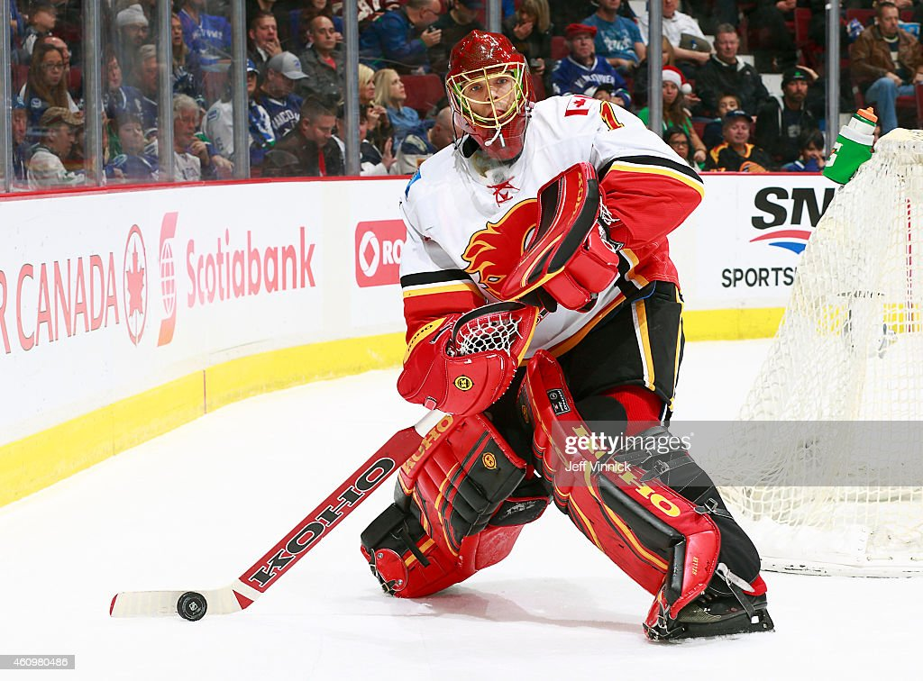Jonas Hiller #1 of the Calgary Flames plays the puck during their NHL game against the Vancouver Canucks at Rogers Arena December 20, 2014 in Vancouver, British Columbia, Canada.