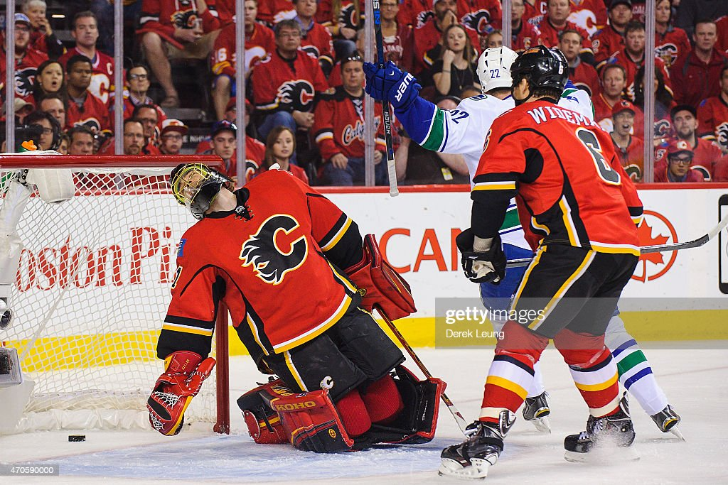 Jonas Hiller #1 of the Calgary Flames reacts after Henrik Sedin (not pictured) of the Vancouver Canucks scored against him in Game Four of the Western Quarterfinals during the 2015 NHL Stanley Cup Playoffs at Scotiabank Saddledome on April 21, 2015 in Calgary, Alberta, Canada.