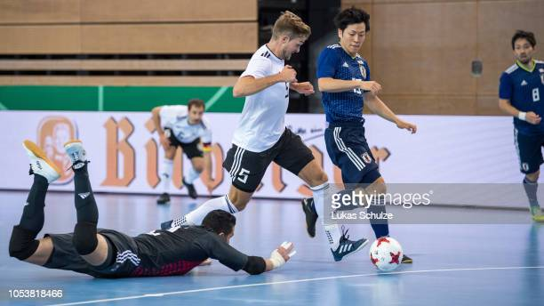 Jonas Hoffmann of Germany challenges for the ball with Goalkeeper Higor Pires and Minami Kato of Japan during the futsal international friendly match...