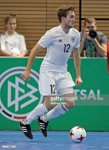 Jonas Hoffmann of Germany runs with the ball during the Futsal international friendly match between Germany and Czech Republic at Ballsport Arena on...