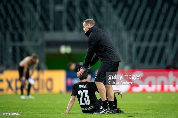 Jonas Hofmann and Assistant Coach Alexander Zickler of Borussia Moenchengladbach react after the Group B - UEFA Champions League match between...