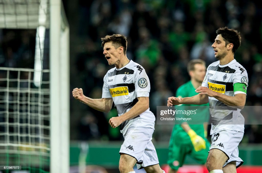 Jonas Hofmann and Lars Stindl of Borussia Moenchengladbach celebrate their team's first goal during the DFB Cup Semi Final between Borussia Moenchengladbach and Eintracht Frankfurt at Borussia-Park on April 25, 2017 in Moenchengladbach, Germany.