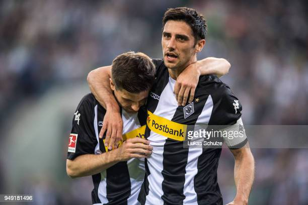 Jonas Hofmann and Lars Stindl of Moenchengladbach celebrate a goal during the Bundesliga match between Borussia Moenchengladbach and VfL Wolfsburg at...