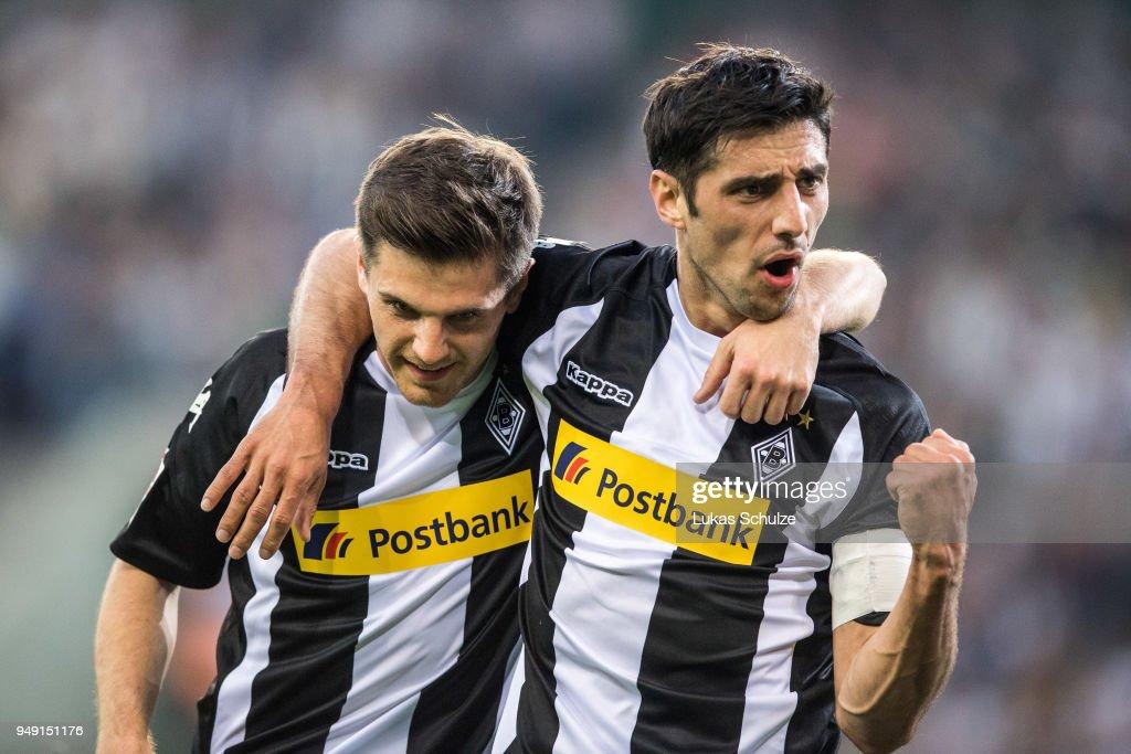Jonas Hofmann (L) and Lars Stindl (R) of Moenchengladbach celebrate their teams second goal during the Bundesliga match between Borussia Moenchengladbach and VfL Wolfsburg at Borussia-Park on April 20, 2018 in Moenchengladbach, Germany.