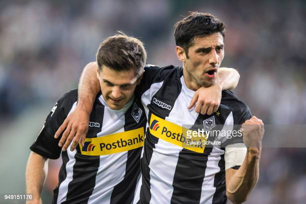 Jonas Hofmann and Lars Stindl of Moenchengladbach celebrate their teams second goal during the Bundesliga match between Borussia Moenchengladbach and...
