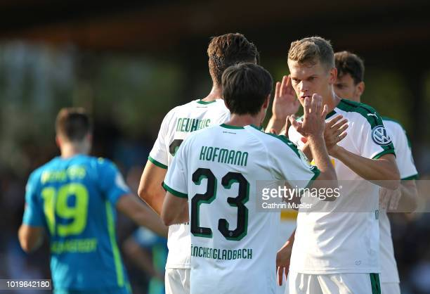 Jonas Hofmann and Matthias Ginter of Borussia Moenchengladbach celebrate after scoring during the DFB Cup first round match between BSC Hastedt and...