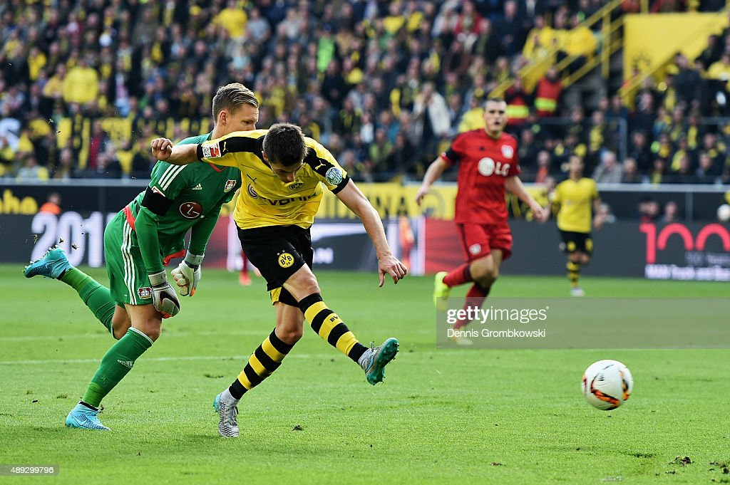 Jonas Hofmann of Borussia Dortmund scores the opening goal past goalkeeper Bernd Leno of Bayer Leverkusen during the Bundesliga match between Borussia Dortmund and Bayer Leverkusen at Signal Iduna Park on September 20, 2015 in Dortmund, Germany.