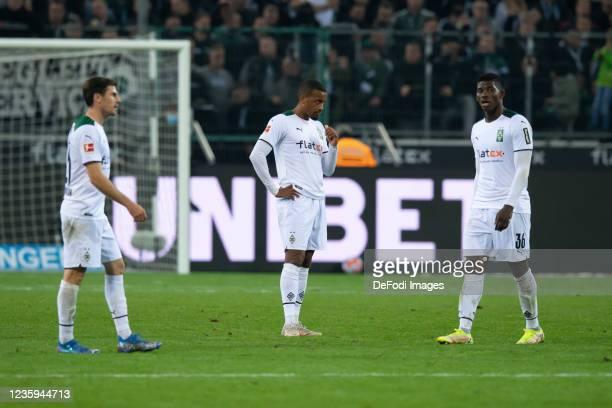 Jonas Hofmann of Borussia Moenchengladbach, Alassane Plea of Borussia Moenchengladbach and Breel Embolo of Borussia Moenchengladbach looks dejected...
