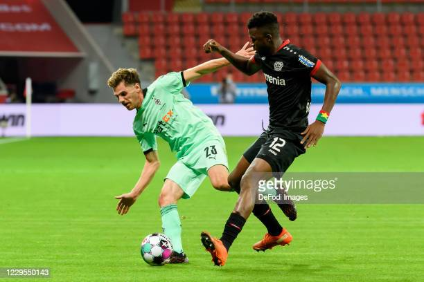Jonas Hofmann of Borussia Moenchengladbach and Edmond Tapsoba of Bayer 04 Leverkusen battle for the ball during the Bundesliga match between Bayer 04...