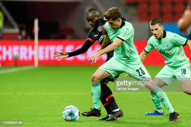 Jonas Hofmann of Borussia Moenchengladbach and Moussa Diaby of Bayer 04 Leverkusen battle for the ball during the Bundesliga match between Bayer 04...