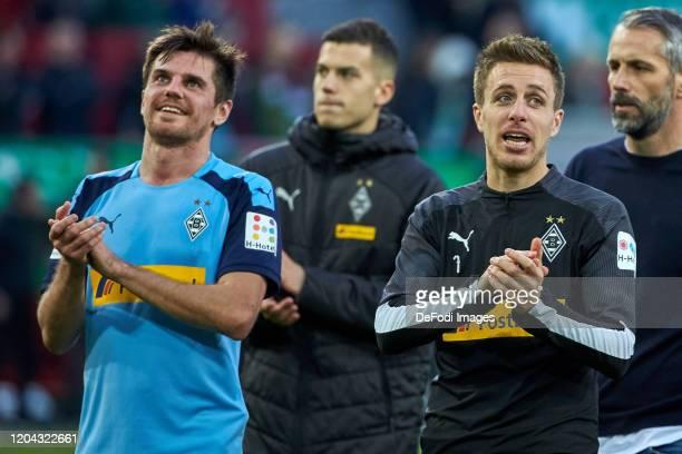 Jonas Hofmann of Borussia Moenchengladbach and Oscar Wendt of Borussia Moenchengladbach look on during the Bundesliga match between FC Augsburg and...